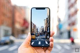 Iemand maakt met zijn smartphone de mooiste foto's